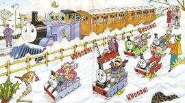 マガジンストーリーのトーマス達を模した橇で遊んでいる子供達を見て喜んでいるトーマス
