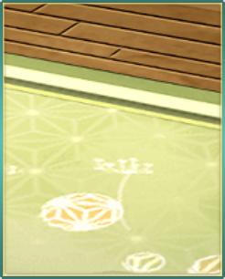 綿毛模様の緑の敷物.png