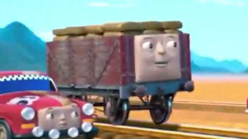 63番のラリーカーと一緒に歌っているコーヒー豆の貨車