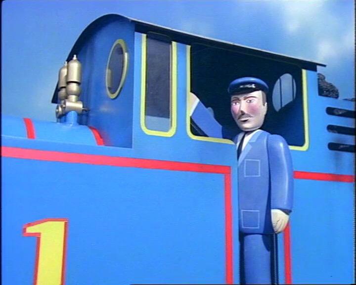 クレーン車を説明しているトーマスの機関士
