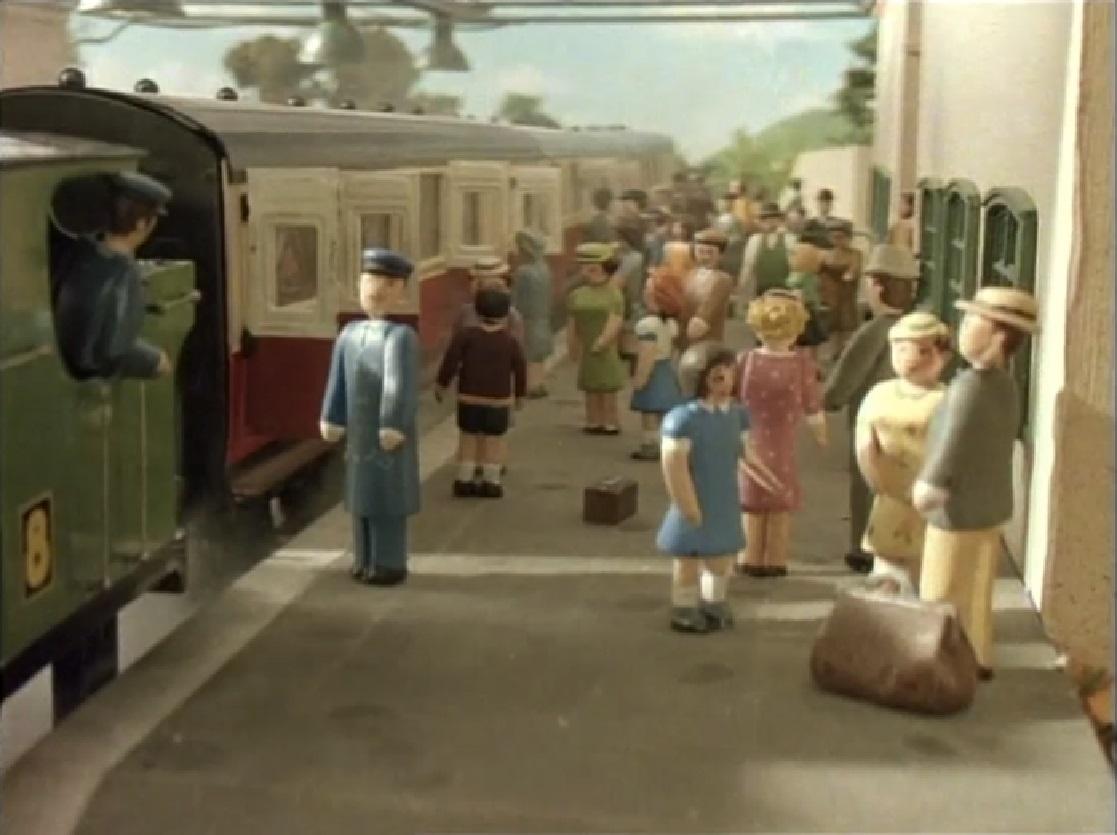 ティッドマス駅で乗客を乗せている急行客車(赤)