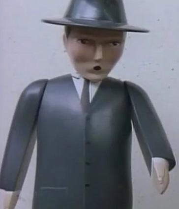 TV版第3シーズンの薄黒いスーツの男性